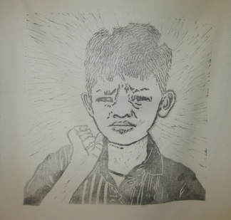 Lino block of young boy by Claire Passmore